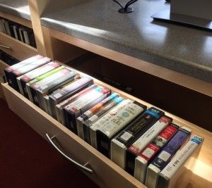 The computer bar was custom designed by Pondside Kitchens to include drawers for the audiobook collection.
