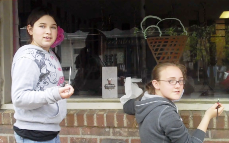 To celebrate High on Life 2011, Diana Carfi, Art Teacher at Deep River Elementary School, and sixth grade students painted windows at businesses along Main Street in Deep River.