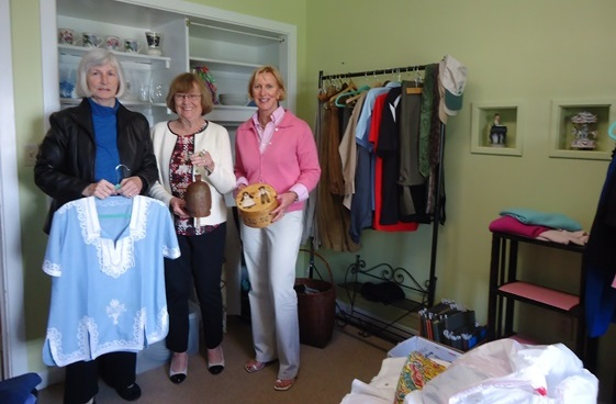 """The idea of Susan Christopher of Essex (far right), a new thrift shop, """"Treasures On The Hill"""" is being created by Susan Nilsen (left) and Connie Connor (center) of Essex at the First Congregational Church in Essex."""