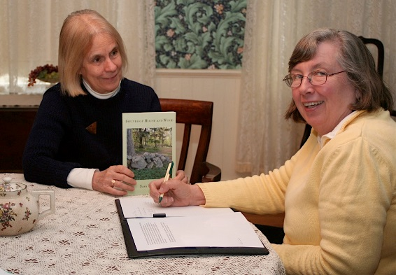 Sara Ingram, author, and curator Rhonda Forristall discuss the upcoming event to be held at the Carriage House. Photo by Susanne Wisner