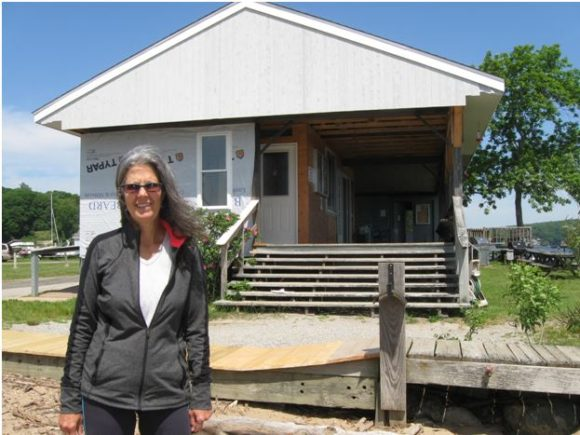 Ann Courcy, Director, Pettipaug Sailing Academy, in front of club house.