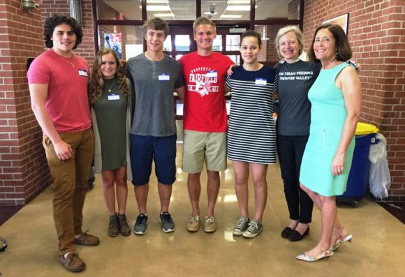 Mary Hambor (right) stands with Ibby Carothers of iCRV Radio and the students who interned at the radio station.