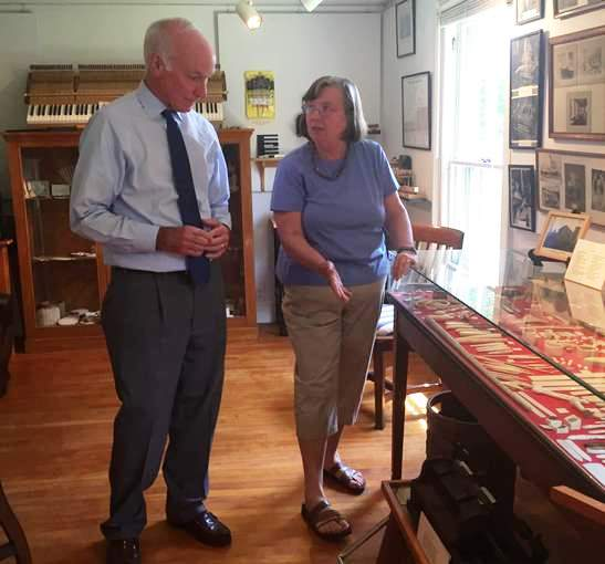 Rep. Joe Courtney talks to Deep River Historical Society curator, Rhonda Forristall. in Stone House on June 1.