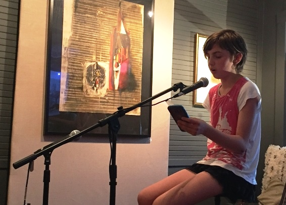 Young people are invited to join in the fun at Open Mic Night at Homage on First Friday. Shown here, Bailey Hilliar reads her poetry at Homage in July.