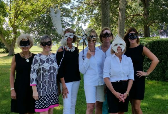 Black and White Masquerade Committee members gather for a photo.