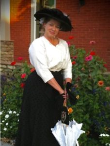 Kandie Carle, here in Edwardian dress, will be one of the Aug. 28 visitors.