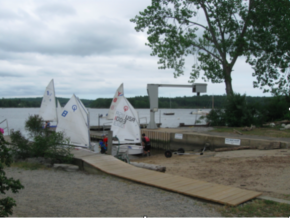 Getting the boats in the water at the Pettipaug Yacht Club.