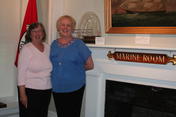 Curator Rhonda Forristall (left) and Kathy Schultz (right) stand in the Deep River Historical Society's Marine Room. All photos by Sue Wisner.