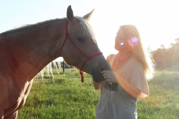 Anna Twinney with her own rescue, Aria, at her home in Elizabeth, Colo.