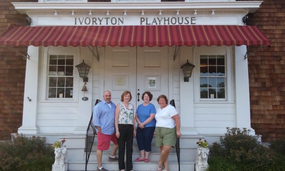 Organizers of Essex Community Fund's Benefit Evening stand in front of the Ivoryton Playhouse, where the event will be held.