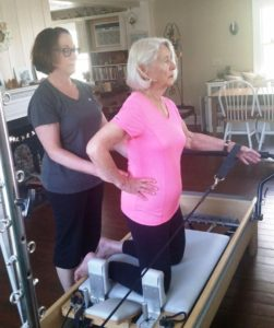 Karen DiRenzio works with a client in her new facility in Essex.