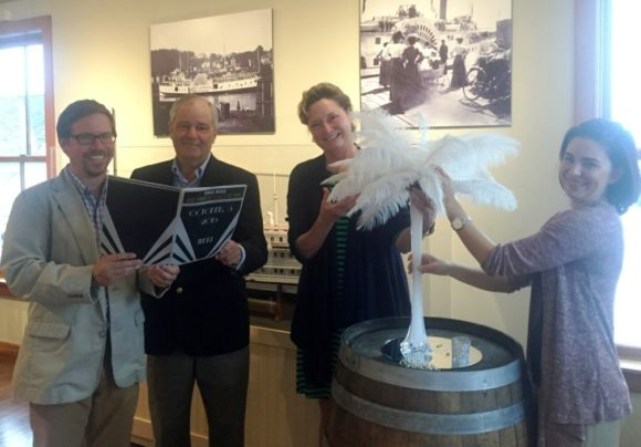 From left to right, Executive Director Chris Dobbs, Museum Chairman Tom Wilcox, Guilford Savings Bank's Lisa LeMonte and Essex Wellness Center's Dana Hatch (left to right) peruse the menu and design centerpieces. Photo courtesy of Connecticut River Museum.