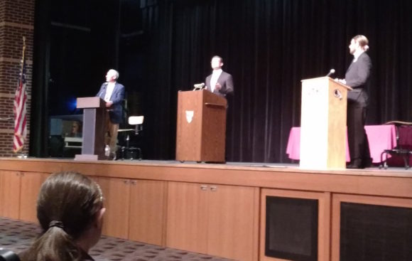 From left to right, Norman Needleman (D), incumbent Sen. Art Linares (R) and Colin Bennett (Green Party) make their opening statements at Monday night's debate.