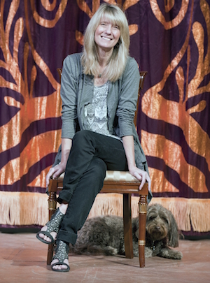 Director Jacqui Hubbard with her dog Lulu, a mutt.