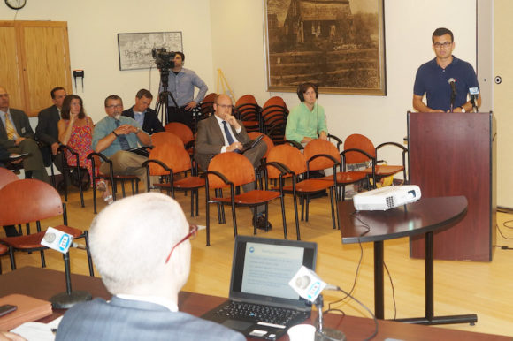 Sen. Art Linares (at podium) on Sept. 1 joined with Rep. Devin Carney (seated in second row) and area commuters attended a public hearing at Old Saybrook Town Hall to testify against the State Department of Transportation's proposed fare hikes on Connecticut rail commuters.