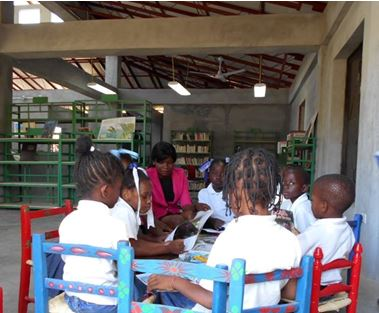 Children enjoy reading together at the Deschapelles Community Library.