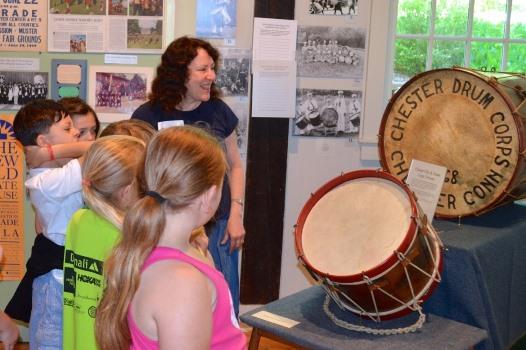 At the Chester Museum at The Mill, early drums from the Chester Fife & Drum Corps are part of the seasonal exhibit, discussed here by museum volunteer Nancy Watkins.