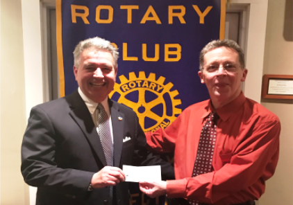 From left to right, Essex Rotary President, Jordan Welles, presents a check to Estuary Council Executive Director, Paul Doyle.